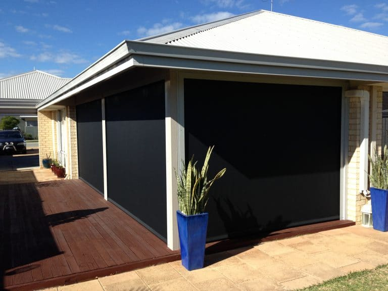 black blinds protecting house form sunlight