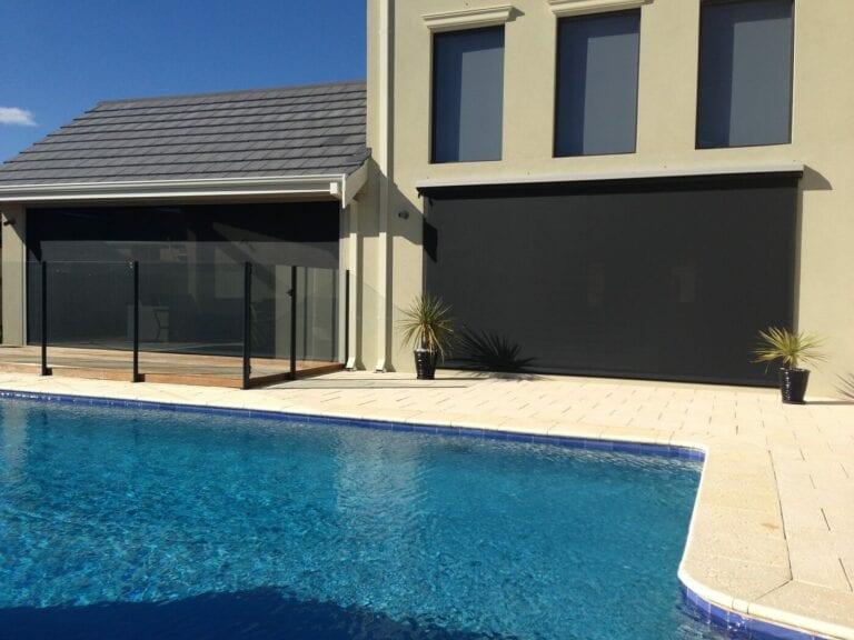 Outdoor blinds on building overlooking swiming pool
