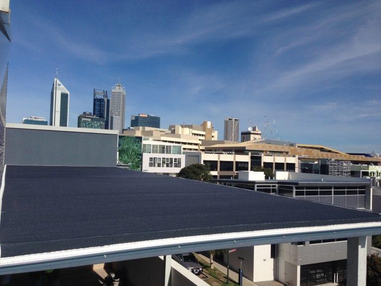 shade sale overlooking building