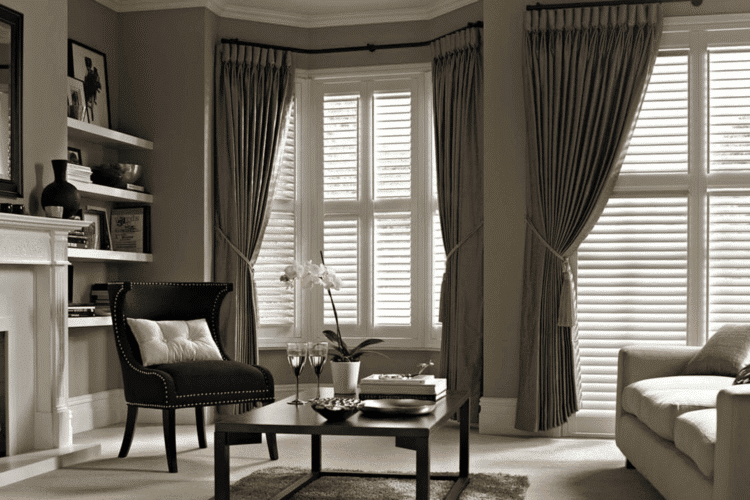 Timber Plantation shutters in nice room with chair and table