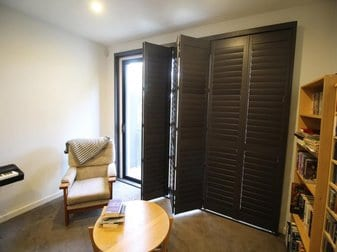 Open Timber Plantation Shutters in small room with chair